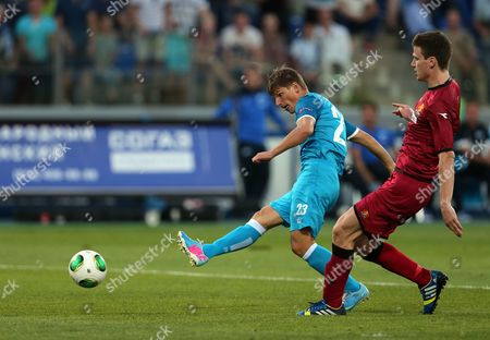 Zenit's Andrey Arshavin (l) Vies For the Ball with Fc Nordsjaelland's Ivan Runje (r) and Scores Against Fc Nordsjaelland During the Uefa Champions League Qualification Soccer Match Between Fc Zenit St Petersburg and Fc Nordsjaelland Denmark in St Petersburg Russia 07 August 2013 Russian Federation St.petersburg