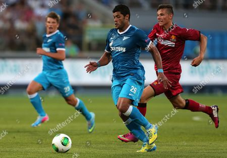 Fc Nordsjaelland's Pascal Gregor (r) Vies For the Ball with Zenit's Hulk (c) and Andrey Arshavin (l) During the Uefa Champions League Qualification Soccer Match Between Fc Zenit St Petersburg and Fc Nordsjaelland Denmark in St Petersburg Russia 07 August 2013 Russian Federation St.petersburg