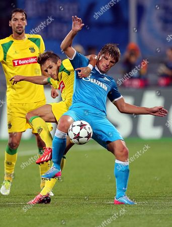 Zenit's Andrey Arshavin (r) in Action Against Pacos De Ferreira's Helder Lopes (c) During the Uefa Champions League Playoff Second Leg Soccer Match Between Fc Zenit St Petersburg and Fc Pacos De Ferreira in St Petersburg Russia 28 August 2013 Zenit Won 8-3 on Aggregate Russian Federation St.petersburg