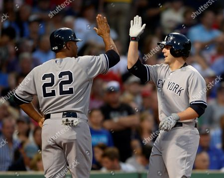 New York Yankees' Vernon Wells (l) Celebrates with Mark Reynolds (r) After Reynolds Hit a Two Run Home Run During the Second Inning Against the Boston Red Sox at Fenway Park in Boston Massachusetts Usa 16 August 2013 United States Boston