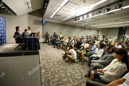 Former New York Yankee Hideki Matsui of Japan (l) Addresses the Media After Signing a Minor League Contract Officially Rejoining the Yankees Organization in Front of the Media Before the Start of the Mlb Game Between the Tampa Bay Rays Vs New York Yankees at Yankee Stadium in the Bronx New York Usa 28 July 2013 to the (far -right) Are His Parents Mother Saeko and Father Masao Matsui Matsui Will Officially Retire on the Field During a Pre-game Ceremony Honoring Him United States Bronx
