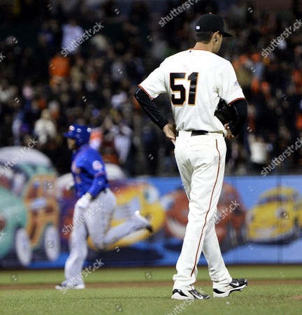 Stock Picture of San Francisco Giants Relief Pitcher Jake Dunning (r) Looks Away After Giving Up a Grand Slam Home Run to New York Mets Marlon Byrd (l) During the Eighth Inning of Their Mlb Game at At&t Park in San Francisco California Usa 09 July 2013 United States San Francisco