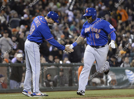 New York Mets Marlon Byrd (r) is Greeted by New York Mets Third Base Coach Tim Teufel (l) After Hitting a Grand Slam Home Run Off a Pitch by San Francisco Giants Relief Pitcher Jake Dunning During the Eighth Inning of Their Mlb Game at At&t Park in San Francisco California Usa 09 July 2013 United States San Francisco