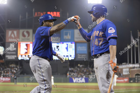 Stock Photo of New York Mets Marlon Byrd (l) is Greeted by Teammate Andrew Brown (r) After Hitting a Grand Slam Home Run Off a Pitch by San Francisco Giants Relief Pitcher Jake Dunning During the Eighth Inning of Their Mlb Game at At&t Park in San Francisco California Usa 09 July 2013 United States San Francisco