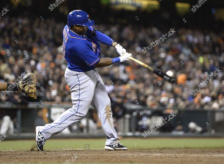 New York Mets Marlon Byrd Connects with a Grand Slam Home Run Off a Pitch by San Francisco Giants Relief Pitcher Jake Dunning During the Eighth Inning of Their Mlb Game at At&t Park in San Francisco California Usa 09 July 2013 United States San Francisco