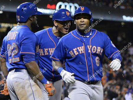 New York Mets Marlon Byrd (r) is Greeted by Teammate Juan Lagares (c) and New York Mets Eric Young Jr (r) After Hitting a Grand Slam Home Run Off a Pitch by San Francisco Giants Relief Pitcher Jake Dunning During the Eighth Inning of Their Mlb Game at At&t Park in San Francisco California Usa 09 July 2013 United States San Francisco