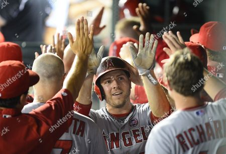 Stock Picture of Los Angeles Angels Player J B Shuck (c) Celebrates with Teammates in the Dugout After Scoring a Run in the Eighth Inning Against the Texas Rangers at Rangers Ballpark in Arlington Texas Usa 30 July 2013 United States Arlington