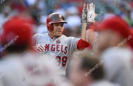 Los Angeles Angels Player J B Shuck (l) Celebrates with Teammates After Hitting a Solo Home Run in the Fifth Inning Against the Texas Rangers at Rangers Ballpark in Arlington Texas Usa 29 July 2013 United States Arlington