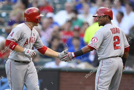 Los Angeles Angels Player J B Shuck (l) Celebrates with Teammate Erick Aybar (r) After Hitting a Solo Home Run in the Fifth Inning Against the Texas Rangers at Rangers Ballpark in Arlington Texas Usa 29 July 2013 United States Arlington