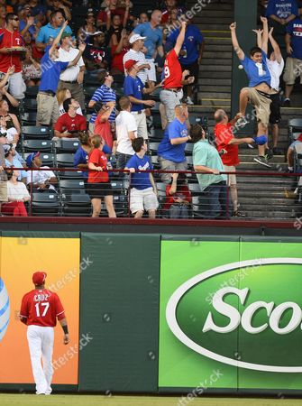 Stock Image of Texas Rangers Player Nelson Cruz Watches Fans Try to Catch a Home Run by Los Angeles Angels Player J B Shuck in the Fifth Inning at Rangers Ballpark in Arlington Texas Usa 29 July 2013 United States Arlington
