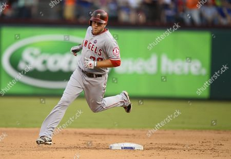 Stock Photo of Los Angeles Angels Player J B Shuck Rounds Second Base After Hitting a Solo Home Run in the Fifth Inning Against the Texas Rangers at Rangers Ballpark in Arlington Texas Usa 29 July 2013 United States Arlington