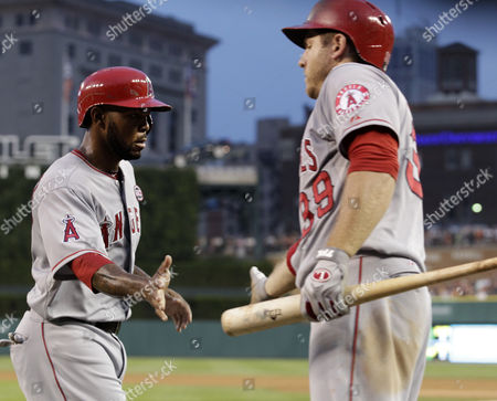 Los Angeles Angels Howie Kendrick (l) is Congratulated by J B Shuck (r) in the Fifth Inning at Comerica Park in Detroit Michigan Usa on 25 June 2013 United States Detroit