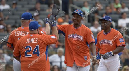 Us Television Personality Boomer Esiason (l) and Us Actor Kevin James (2nd L) Congratulate Mlb Legend Darryl Strawberry (2nd R) and Legend Andre Dawson (r) After a Home Run During the Major League Baseball All-star Legends and Celebrity Softball Game at Citi Field in Flushing New York Usa 14 July 2013 the Baseball All-star Week Culminates with the Annual Mid-season Match-up of the Best of the American and National Leagues Playing For Home Field Advantage in October's World Series United States Flushing