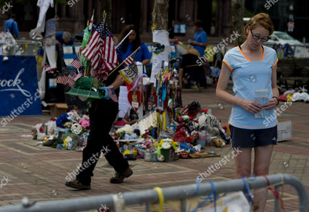 Stock Image of Sarah Baxter (r) of Bath Britain Looks Over the Remaining Portion of the Boston Marathon Memorial Site As City Employees Volunteers and Employees of Polygon an Archiving Company Remove the Remaining Items From the Site at Copley Square in Boston Massachusetts Usa 25 June 2013 For Permanent Storage at the City Archives with Plans For a Permanent Memorial in the Future Three Spectators Krystal Campbell Lu Lingzi and Martin Richards Were Killed As Well As Hundreds Others Injured when Tamerlan and Dzhokhar Tsarnaev Triggered Two Explosive Devices at the Finish Line Area of the Boston Marathon on 15 April 2013 Massachusetts Institute of Technology Police Officer Sean Collier was Allegedly Shot and Killed by the Brothers As They Prepared to Flee Boston Three Days Later and Resulted in the Death of Tamerlan Tsarnaev and the Capture of Dzhokhar Tsarnaev in the Nearby Town of Watertown After an Intense Manhunt United States Boston