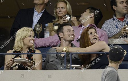 Stock Photo of (l-r) Us Actress Megan Hilty and Boyfriend Brian Gallagher and Actress Debra Messing Attend the Fifth Day of the 2013 Us Open Tennis Championship at the Usta National Tennis Center in Flushing Meadows New York Usa 26 August 2013 the Us Open Runs Through 09 September a 15-day Schedule For the First Time United States Flushing Meadows