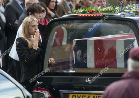 Stock Photo of A Mourner Blows a Kiss to a Departed Loved One After the Repatriations of Capt Thomas Clarke Warrant Officer Spencer Faulkner and Cpl James Walters All From the Army Air Corps; and Raf Intelligence Officer Flt Lt Rakesh Chauhan and L/cpl Oliver Thomas Both of the Intelligence Corps who Were Killed in a Helicopter Crash 26 April 2014 Afghanistan Wootton Bassett Britain the Public Send-off at Carterton Followed the Repatriations at Raf Brize Norton Oxfordshire Most of the Isaf Troops Stationed in the Volatile Southern Areas Are Americans Britons and Canadians United Kingdom Wootton Bassett