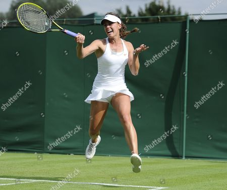 Michelle Larcher De Brito of Portugal Returns to Melanie Oudin of Usa During Their First Round Match For the Wimbledon Championships at the All England Lawn Tennis Club in London Britain 24 June 2013 United Kingdom Wimbledon