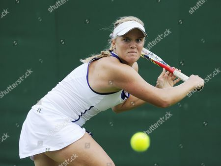 Melanie Oudin of Usa Returns to Michelle Larcher De Brito of Portugal During Their First Round Match For the Wimbledon Championships at the All England Lawn Tennis Club in London Britain 24 June 2013 United Kingdom Wimbledon