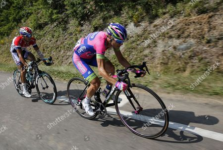 Dutch Rider Johnny Hoogerland (l) of the Vacansoleil Dcm Procycling Team and Italian Rider Damiano Cunego (r) of the Lampre Merida Procycling Team in Action During the 14th Stage of the 100th Edition of the Tour De France 2013 Cycling Race Between Saint-pourcain-sur-sioule and Lyon France 13 July 2013 France Lyon
