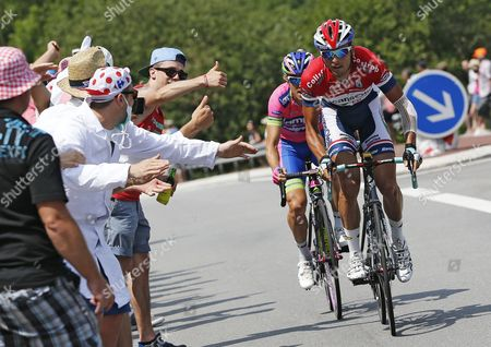Dutch Rider Johnny Hoogerland (r) of the Vacansoleil-dcm Procycling Team and Italian Rider Damiano Cunego (c) of the Lampre-merida Procycling Team in Action During the 14th Stage of the 100th Edition of the Tour De France 2013 Cycling Race Between Saint-pourcain-sur-sioule and Lyon France 13 July 2013 France Lyon