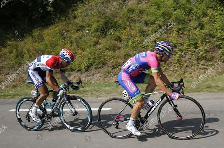 Stock Image of Dutch Rider Johnny Hoogerland (l) of the Vacansoleil Dcm Procycling Team and Italian Rider Damiano Cunego (r) of the Lampre Merida Procycling Team in Action During the 14th Stage of the 100th Edition of the Tour De France 2013 Cycling Race Between Saint-pourcain-sur-sioule and Lyon France 13 July 2013 France Lyon