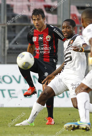 Dario Cvitanich of Ogc Nice (l) Vies For the Ball with Jean Ii Makoun of Rennes (r) During the French League One Soccer Match Between Ogc Nice and Rennes at Le Ray Stadium in Nice France 17 August 2013 France Nice