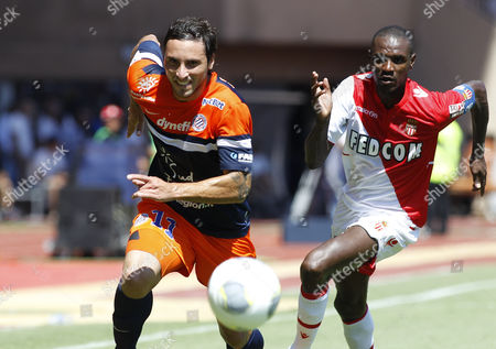 Eric Abidal of As Monaco (r) Vies For the Ball with Emanuel Herrera of Montpellier (l) During the French Ligue 1 Soccer Match As Monaco Vs Montpellier at Stade Louis Ii in Monaco 18 August 2013 Monaco Monaco