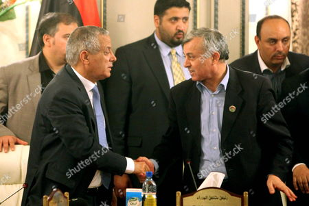 Head of the General National Congress Nouri Bousahmein (r) Shakes Hands with Libyan Prime Minister Ali Zeidan (l) During a Press Conference Shortly After His Release in Tripoli Libya 10 October 2013 Zeidan was Released on 10 October After Being Briefly Held Captive by Armed Men in the Capital Tripoli Local Media Quoted Him As Saying That Militiamen Whom He Did not Name Had Captured Him to Force Him to Quit His Post the Circumstances of Zeidan's Seizure From the Corinthia Hotel in Tripoli where He was Staying Remained Unclear Libyan Arab Jamahiriya Tripoli