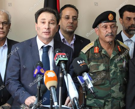 Libyan First Deputy Prime Minister and Acting Interior Minister Sadiq Abdulkarim Abdulrahman (l) and Chief of Staff of the Libyan Armed Forces Major-general Abdulsalam Jadallah (r) During a Press Conference on the Kidnapping of Prime Minister Ali Zeidan in Tripoli Libya 10 October 2013 Zeidan was Released on 10 October After Being Briefly Held Captive by Armed Men in the Capital Tripoli Local Media Quoted Him As Saying That Militiamen Whom He Did not Name Had Captured Him to Force Him to Quit His Post the Circumstances of Zeidan's Seizure From the Corinthia Hotel in Tripoli where He was Staying Remained Unclear Libyan Arab Jamahiriya Tripoli