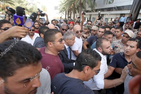 Libyan Prime Minister Ali Zeidan (c) Arrives at the Government Headquarters Shortly After His Release in Tripoli Libya 10 October 2013 Zeidan was Released on 10 October After Being Briefly Held Captive by Armed Men in the Capital Tripoli Local Media Quoted Him As Saying That Militiamen Whom He Did not Name Had Captured Him to Force Him to Quit His Post the Circumstances of Zeidan's Seizure From the Corinthia Hotel in Tripoli where He was Staying Remained Unclear Libyan Arab Jamahiriya Tripoli