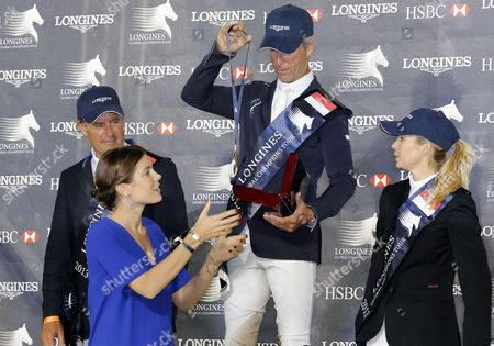 Us Rider Richard Spooner (c) Receives the Trophy From Charlotte Casiraghi (front L) Daughter of Princess Caroline of Hanover After Winning the Horse Jumping Competition at the End of the Monte-carlo International Jumping Monaco 29 June 2013 Monaco Monte Carlo