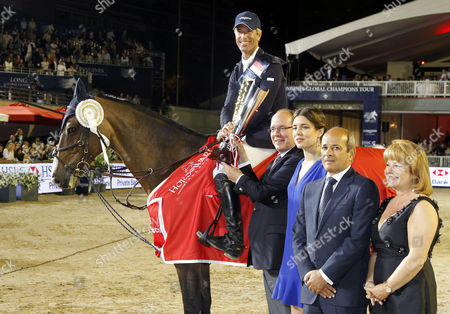 Stock Image of From L-r Us Rider Richard Spooner who Won the Horse Jumping Competition Prince Albert Ii of Monaco Charlotte Casiraghi Daughter of Princess Caroline of Hanover Unidentified Person and Diane Fissore-wathelet Pose at the End of the Monte-carlo International Jumping Monaco 29 June 2013 Monaco Monte Carlo