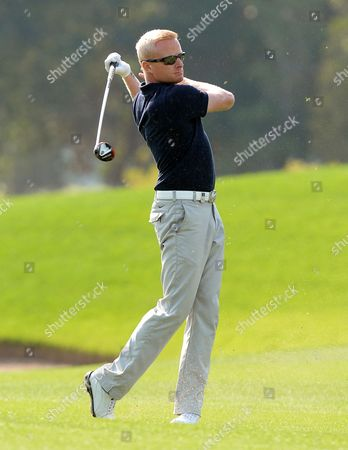 Stock Picture of Simon Dyson of England Watches His Shot During the Third Round of the Qatar Masters Golf Tournament at the Doha Golf Club in Doha Qatar 24 January 2014 Qatar Doha