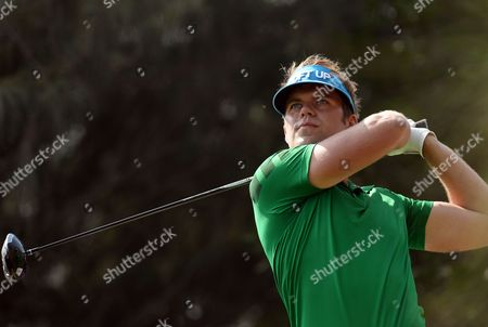 Johan Carlsson of Sweden Watches His Shot During the Final Round of the Qatar Masters Golf Tournament at the Doha Golf Club in Doha Qatar 25 January 2014 Qatar Doha