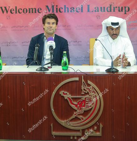 Newly Appointed Qatar's Lekhwiya Sports Club Soccer Head Coach Michael Laudrup (l) of Denmark and Lekhwiya's Khalifa Khamis (r) Attend News Conference at the Press Centre of the Lekhwiya Sports Club Stadium in Doha-qatar on 02 July 2014 Qatar Doha