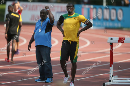 Stock Image of A Jamaican Sprinter Usain Bolt (r) and His Coach Glen Mills Od (c) Attend in Jamaica Athletic Team Opening Training Session Before Iaaf World Athletics Championships in Moscow Russia 08 August 2013 the Iaaf World Athletics Championships 2013 Will Start in Moscow on 10 August Russian Federation Moscow
