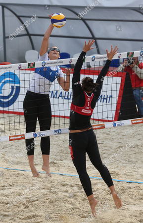 Victoria Orsi Toth of Italy (l) and Liliana Fernandez Steiner of Spain (r) in Action During the Third Place Match at the Moscow Grand Slam Beach Volleyball Tournament in Moscow Russia 25 August 2013 Russian Federation Moscow