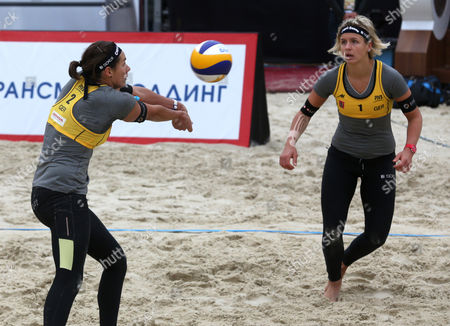 Laura Ludwig (r) and Kira Walkenhorst of Germany (l) in Action During Their Semi-final Match Against Marta Menegatti and Victoria Orsi Toth of Italy at the Moscow Grand Slam Beach Volleyball Tournament in Moscow Russia 25 August 2013 Russian Federation Moscow