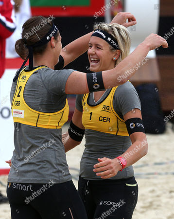 Laura Ludwig (r) and Kira Walkenhorst of Germany (l) Jubilate Their Victory in Semi-final Match Against Marta Menegatti and Victoria Orsi Toth of Italy at the Moscow Grand Slam Beach Volleyball Tournament in Moscow Russia 25 August 2013 Russian Federation Moscow