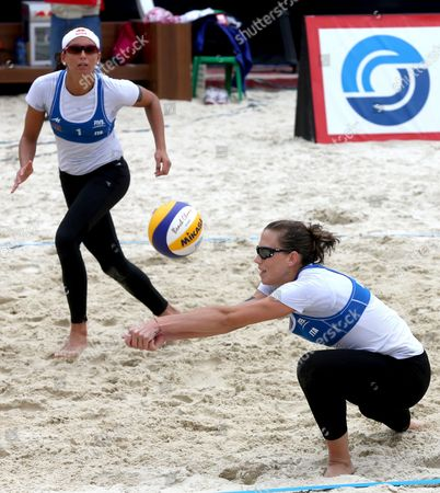 Marta Menegatti (l) and Victoria Orsi Toth (r) of Italy in Action During Their Third Place Match Against Liliana Fernandez Steiner of and Elsa Baquerizo Mcmillan of Spain at Moscow Grand Slam Tournament Russia 25 August 2013 Russian Federation Moscow