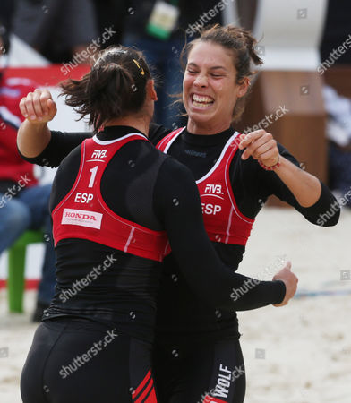 Liliana Fernandez Steiner of (l) and Elsa Baquerizo Mcmillan (r) of Spain Jubilate After Winning Third Place Match Against Marta Menegatti and Victoria Orsi Toth of Italy at the Moscow Grand Slam Beach Volleyball Tournament in Moscow Russia 25 August 2013 Russian Federation Moscow