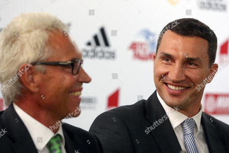Ukrainian Total World Champion (wba (super) Ibf Wbo Ibo) Wladimir Klitschko (r) and His Manager Bernd Boente (l) Attend a Press Conference in Moscow Russia 12 August 2013 Teams of Klitschko and Russian Professional Heavyweight Boxer Olympic Champion Alexander Povetkin Agreed to Arrange a Bout For the World Championship Title Between the Two Champions in Moscow 05 October 2013 Russian Federation Moscow