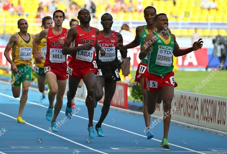 Ethiopia's Hagos Gebrhiwet (r) and Bernard Lagat (c) of the Usa Compete During the Men's 5000m Heats at the 14th Iaaf World Championships at Luzhniki Stadium in Moscow Russia 13 August 2013 Russian Federation Moscow