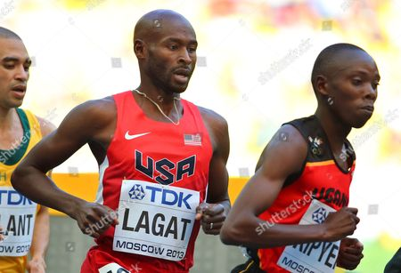 Bernard Lagat (c) of the Usa and Uganda's Phillip Kipyeko (r) Compete During the Men's 5000m Heats at the 14th Iaaf World Championships at Luzhniki Stadium in Moscow Russia 13 August 2013 Russian Federation Moscow