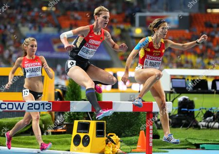 Germany's Gesa Felicitas Krause (l) Antje Moeldner-schmidt (c) and Spain's Diana Martin (r) Compete in the Women's 3 000m Steeplechase Final at the 14th Iaaf World Championships at Luzhniki Stadium in Moscow Russia 13 August 2013 Russian Federation Moscow