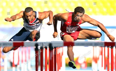 Britain's William Sharman (l) and Ryan Wilson (r) of the Usa in Action During the Men's 110m Hurdles Heats at the 14th Iaaf World Championships at Luzhniki Stadium in Moscow Russia 11 August 2013 Russian Federation Moscow