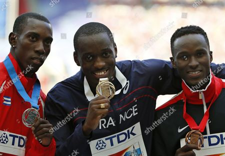 Gold Medalist Teddy Tamgho (c) of France is Flanked on the Podium by Second Placed Pedro Pablo Pichardo (l) of Cuba and Third Placed Will Claye (r) of the Usa During the Medal Ceremony For the Men's Triple Jump at the 14th Iaaf World Championships at Luzhniki Stadium in Moscow Russia 18 August 2013 Russian Federation Moscow