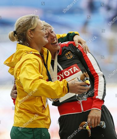 Gold Medalist Christina Obergfoell (r) of Germany and Silver Medalist Kimberley Mickle (l) of Australia During the Medal Ceremony For the Women's Javelin Throw at the 14th Iaaf World Championships at Luzhniki Stadium in Moscow Russia 18 August 2013 Russian Federation Moscow