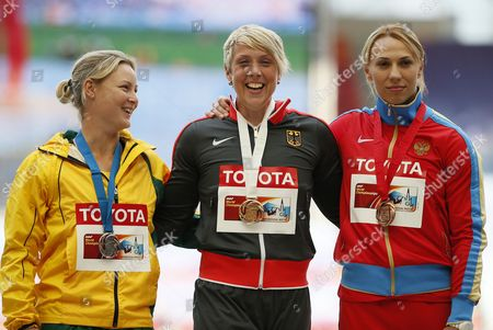 Gold Medalist Christina Obergfoell (c) of Germany is Flanked by Silver Medalist Kimberley Mickle (l) of Australia and Bronze Winner Maria Abakumova During the Medal Ceremony For the Women's Javelin Throw at the 14th Iaaf World Championships at Luzhniki Stadium in Moscow Russia 18 August 2013 Russian Federation Moscow