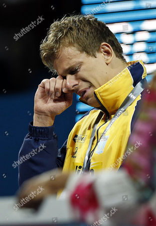 Cesar Cielo Filho of Brazil Cries During the Award Ceremony After Winning the Men's 50m Freestyle Final at the 15th Fina Swimming World Championships at Palau Sant Jordi Arena in Barcelona Spain 03 August 2013 Spain Barcelona
